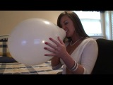 Blow and nail pop white balloon